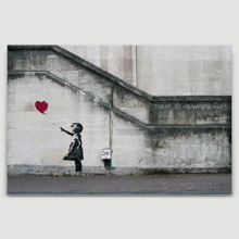 Banksy canvas home wall art featuring his work Girl With Balloon there is always hope hanging on a beige wall.
