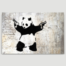 Banksy canvas home wall art featuring his work Panda With Guns Stick Em Up hanging on a beige wall.