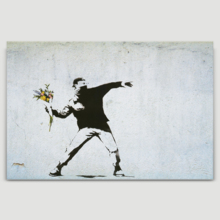 Banksy canvas home wall art featuring his work Rage The Flower Thrower love is in the air hanging on a beige wall.