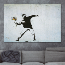 Banksy canvas wall art print of his famous work Rage The Flower Thrower love is in the air in a modern living room.