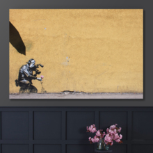 Camera Man With Flowers by Banksy